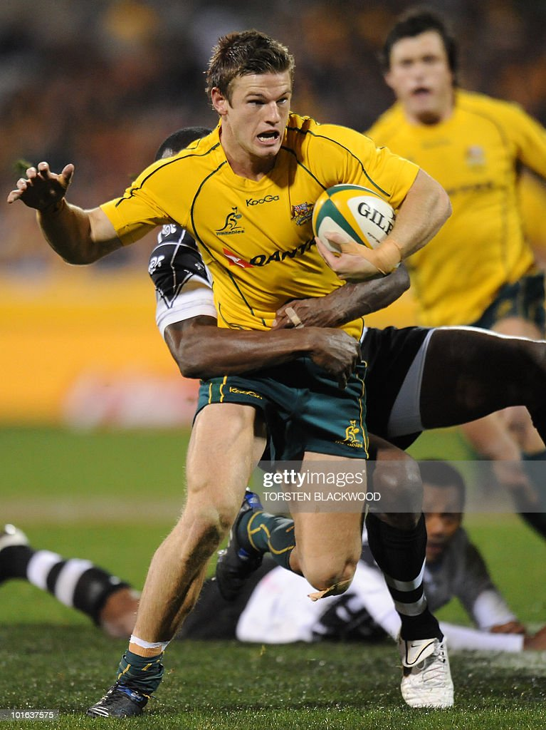 Wallaby centre Rob Horne is tackled as he tries to break through the Fijian defence during the Australia v Fiji rugby union Test in Canberra on June 5, 2010. Australia thrashed Fiji 49-3. AFP PHOTO / Torsten BLACKWOOD