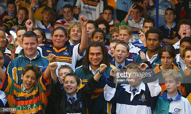 Wallaby players Matt Burke, George Smith and Lote Tuqiri pose with kids during the Rugby World Cup 2003 True Colours launch at Martin Place August...