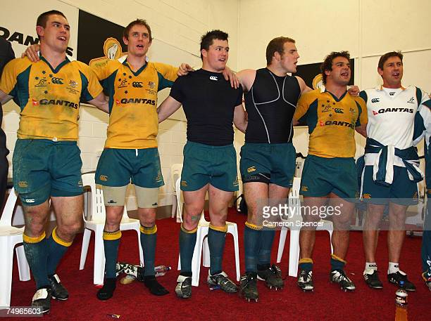 Wallaby players sing the national anthem in their changeroom after winning the 2007 Tri Nations match between Australia and New Zealand at the...