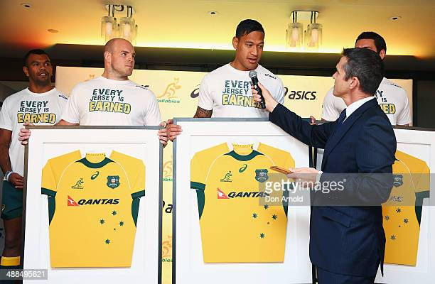Wallaby squad members Kurtley Beale Stephen Moore and Dave Dennislook on as Israel Folau is interviewed by Nick McArdle during the ASICS Wallabies...