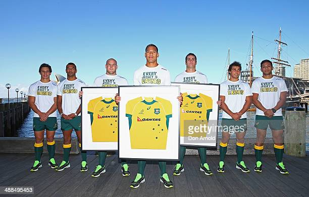 Wallaby squad members Matt Toomua Kurtley Beale Stephen Moore Israel Folau Dave Dennis Nick Phipps and Christian Lealiifanu pose during the ASICS...