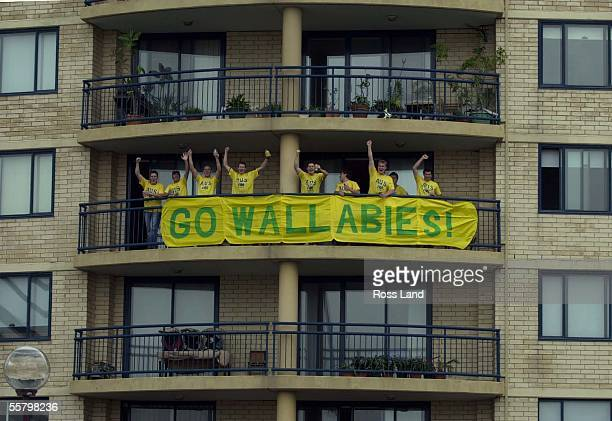 Wallaby supporters wave to the traffic from their apartment on the way to the Telstra Stradium where the final of the 2003 Rugby World Cup will be...