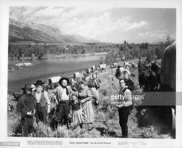 Wallace Beery Margaret O'Brien Marjorie Main standing in a group by the river in a scene from the film 'Bad Bascomb' 1946