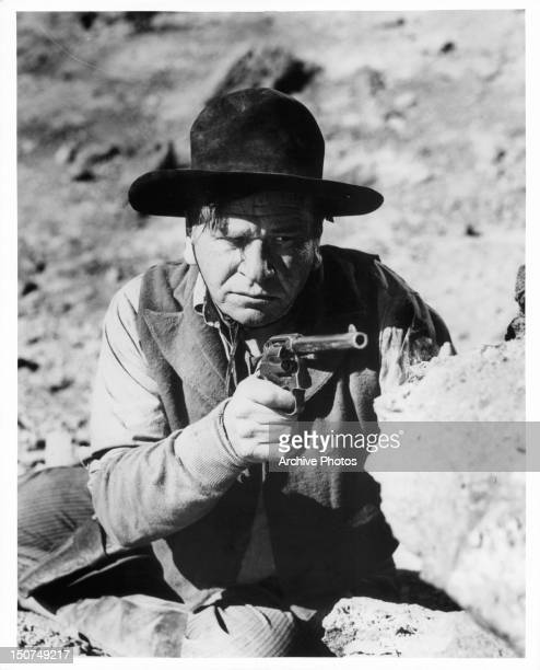 Wallace Beery pointing pistol in a scene from the film '20 Mule Team' 1940