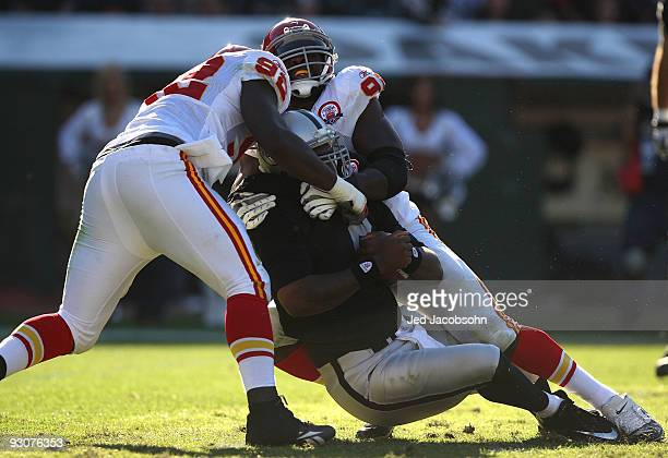 Wallace Gilberry and Tamba Hali of the Kansas City Chiefs sack JaMarcus Russell of the Oakland Raiders during an NFL game at OaklandAlameda County...