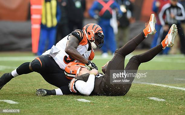 Wallace Gilberry of the Cincinnati Bengals sacks Johnny Manziel of the Cleveland Browns during the first quarter at FirstEnergy Stadium on December...