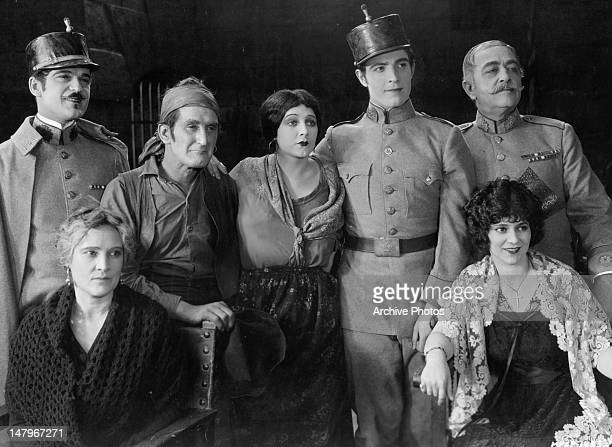 Wallace MacDonald Claire McDowell William V Mong Barbara La Marr Ramon Novarro Edith Roberts and Robert Edeson pose for picture for the film 'Thy...