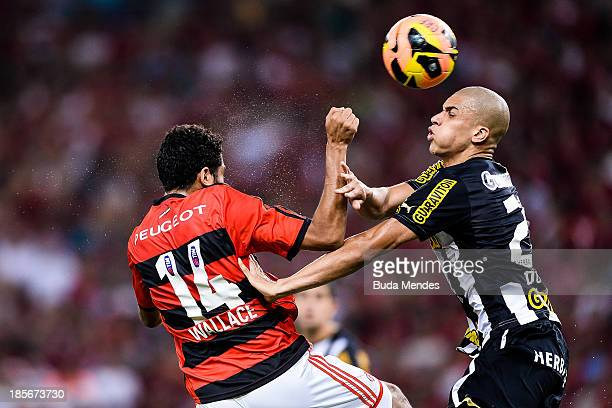 Wallace of Flamengo struggles for the ball with Doria of Botafogo during a match between Flamengo and Botafogo as part of Brazilian Cup 2013 at...