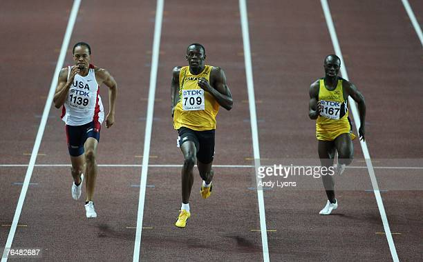 Wallace Spearmon of the United Stated of America Usain Bolt of Jamaica and Brian Dzingai of Zimbabwe compete in the Men's 200m semi final on day five...
