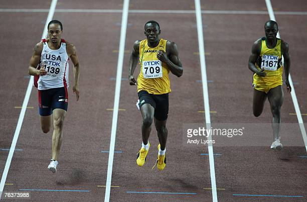 Wallace Spearmon of the United States of America Usain Bolt of Jamaica and Brian Dzingai of Zimbabwe compete in the Men's 200m semi final on day five...