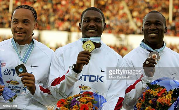 Wallace Spearmon of USA Justin Gatlin of USA and John Capel of USA pose for a picture during the medal ceremony for the mens 200 Metres at the 10th...