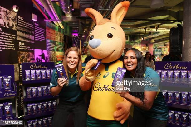 Wallaroos players Emily Chancellor and Mahalia Murphy pose with 'Wally' the mascot after Cadbury was announced as a major sponsor of the Wallabies...