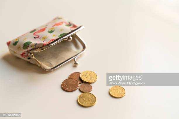 wallet and euro coins - clutch bag stock pictures, royalty-free photos & images