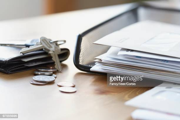 wallet and keys near inbox - outbox filing tray stock pictures, royalty-free photos & images