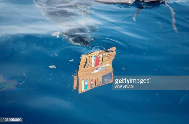 TOPSHOT A wallet belonging to a passenger of the illfated Lion Air flight JT 610 floats at sea in the waters north of Karawang West Java province on...