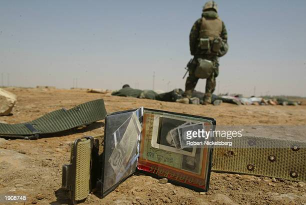 Wallet from an Iraqi soldier taken prisoner by U.S. Marines of the 1st Marine Division lies on the ground April 1, 2003 in Diwaniya, Iraq. Diwaniya,...