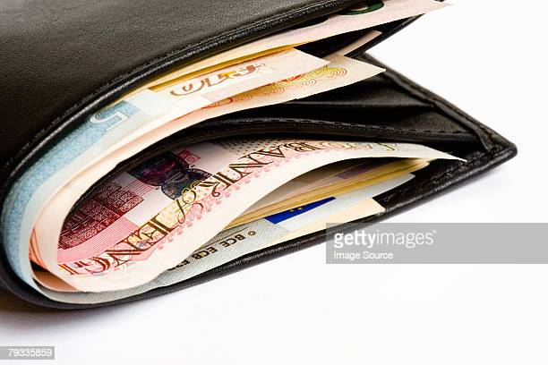 wallet - british pound sterling note stock pictures, royalty-free photos & images