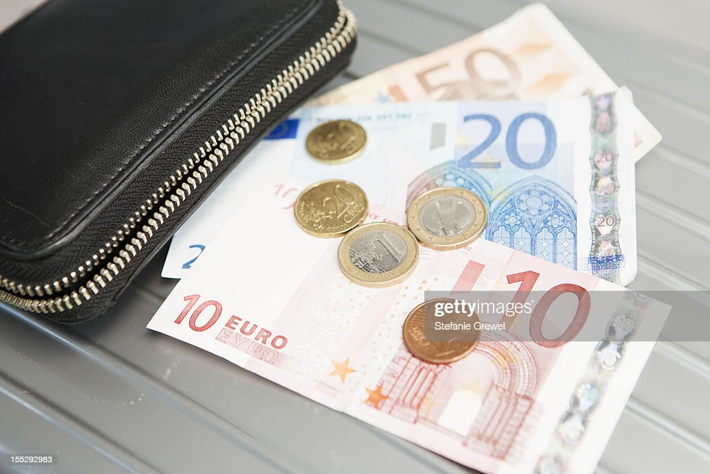Wallet with euro notes and coins : Stock Photo