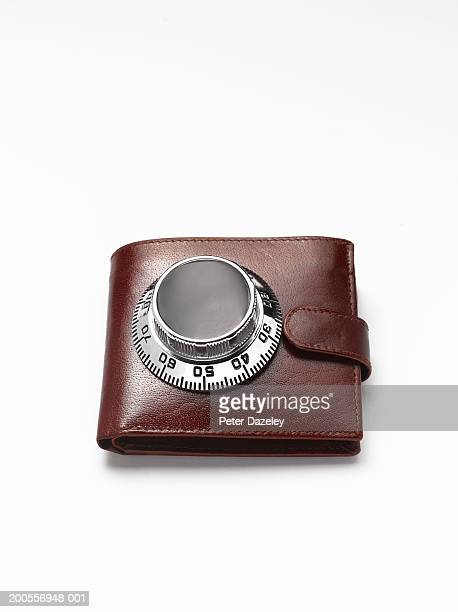 wallet with safe dial on, close-up - miserly stock pictures, royalty-free photos & images