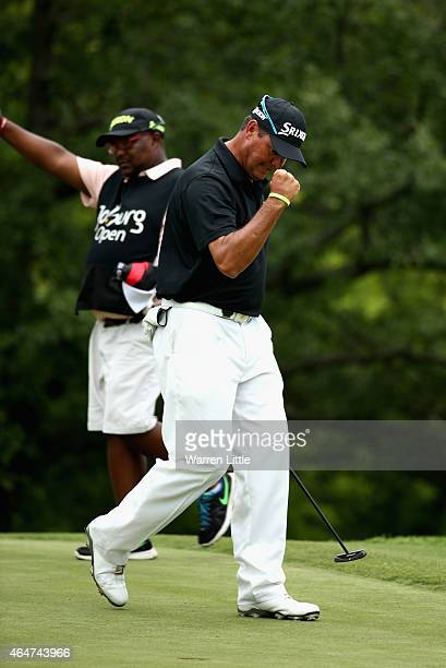Wallie Coetsee of South Africa celebrates a birdie on the 18th green during the third round of the Joburg Open at Royal Johannesburg and Kensington...