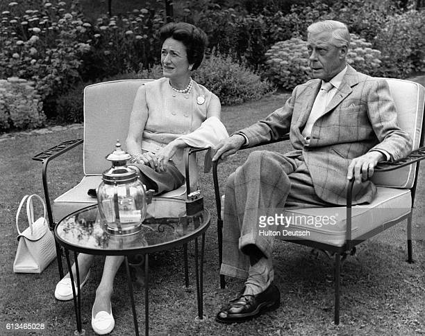 Wallis and Edward Duke and Duchess of Windsor in the garden of their country home a converted mill in GifsurYvette The Duke is the former King Edward...