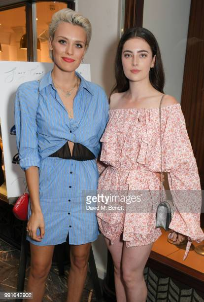Wallis Day and Millie Brady attend the Manolo Blahnik Colourful Garden Party at Burlington Arcade on July 4 2018 in London England