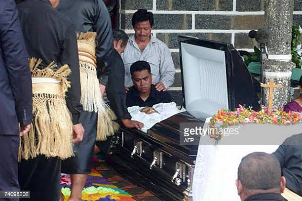 People pay their last respects 08 May 2007 at Mata'Utu cathedral to Tomasi Kulimoetoke the king of the tiny French Pacific island of Wallis who died...