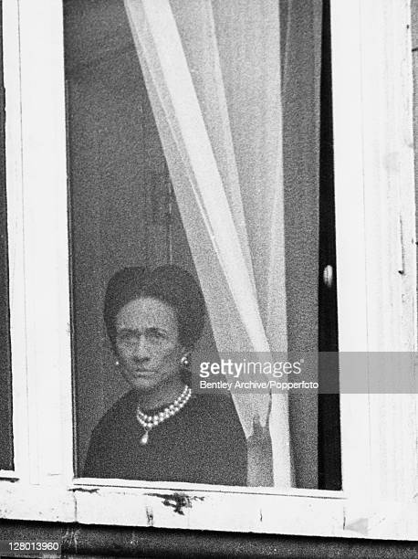 Wallis Simpson Duchess of Windsor watches the Trooping the Colour ceremony from her window at Buckingham Palace on what would have been her 35th...