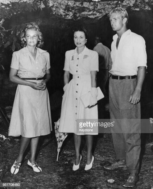 Wallis Simpson, the Duchess Of Windsor with actors Madeleine Carroll and Sterling Hayden in the Bahamas, during the filming of 'Bahama Passage', 1st...