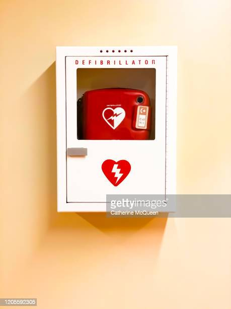 wall-mounted emergency heart defibrillator - cardiac arrhythmia stock pictures, royalty-free photos & images