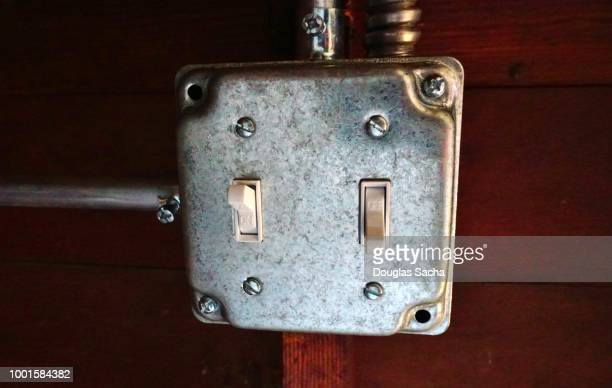 Wall-mounted toggle switch in a two gang Zinc Plated Steel Switch Box