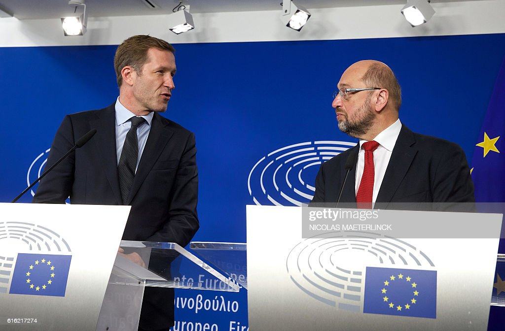 Wallonia's socialist government head Paul Magnette (L) and European Parliament President Martin Schulz hold a joint press conference after their meeting regarding CETA (EU-Canada Comprehensive Economic and Trade Agreement) at the European Parliament in Brussels on October 22, 2016. The head of the European parliament and Canada's trade minister held last-ditch talks on October 22 aimed at salvaging a trade deal threatened by a Belgian region's refusal to sign on. EU assembly chief Martin Schulz also planned an 11th-hour huddle with Paul Magnette, head of Wallonia's socialist government which is blocking the agreement between Ottawa and the 28-nation European Union. Belga / NICOLAS MAETERLINCK / Belgium OUT