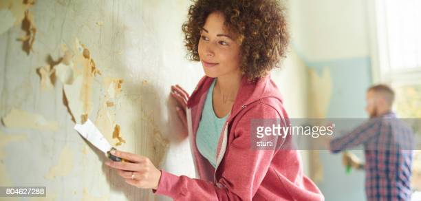wallpaper scraping - home improvement stock pictures, royalty-free photos & images
