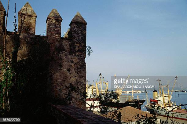 Walls of Kasbah Fort 12th16th century with the harbour in the background Bejaia Algeria
