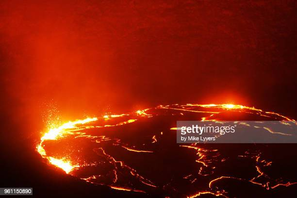 walls of pu'u o'o crater illuminated by the lava lake, may 2011. - pu'u o'o vent stock pictures, royalty-free photos & images