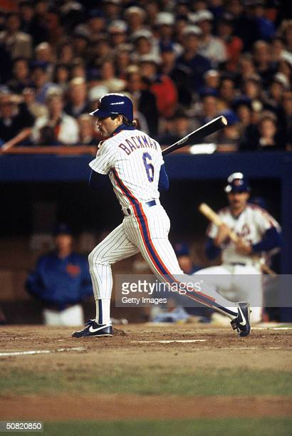 Wally Backman of the New York Mets follows through on his swing during Game7 of the1986 World Series against the Boston Red Sox at Shea Stadium on...