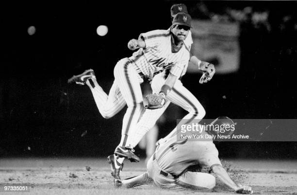Wally Backman of the New York Mets makes a double play against the Montreal Expos