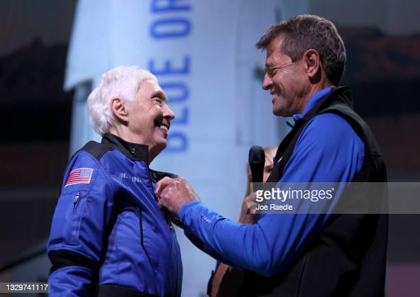 Wally Funk receives astronaut wings from Blue Origin's Jeff Ashby, a former Space Shuttle commander, after her flight on Blue Origin's New Shepard...