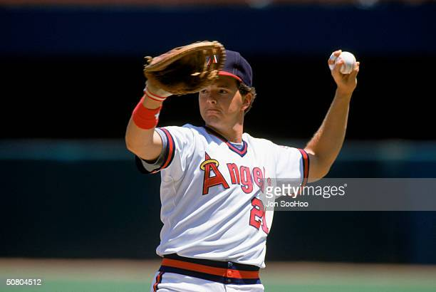 Wally Joyner of the California Angels throws the ball during a game at Anaheim Stadium in Anaheim California Joyner played for the Angels from...