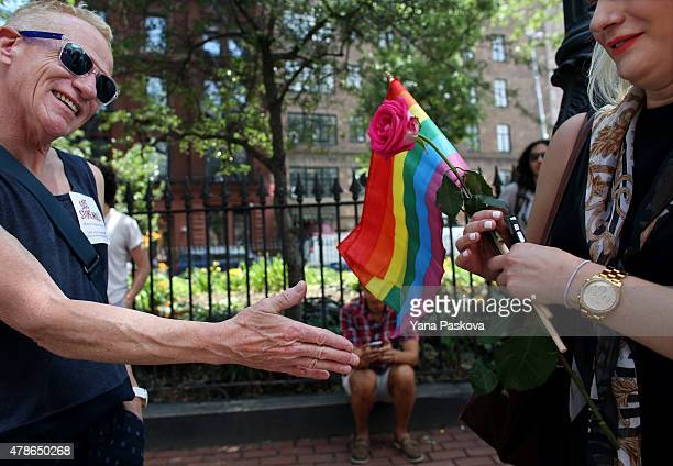 Wally Kallenback from Maine chats with Marielle Rocca from Brooklyn outside of the Stonewall Inn an iconic gay bar recently granted historic landmark...