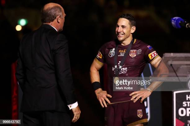 Wally Lewis speaks to Billy Slater of Queensland after presenting him with the Player of the Series medal after game three of the State of Origin...