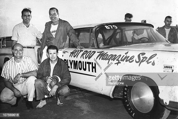 Wally Parks founder of the National Hot Rod Association and Hot Rod Magazine and Hot Rod Magazine Technical Advisor Ray Brock pose with the rest of...