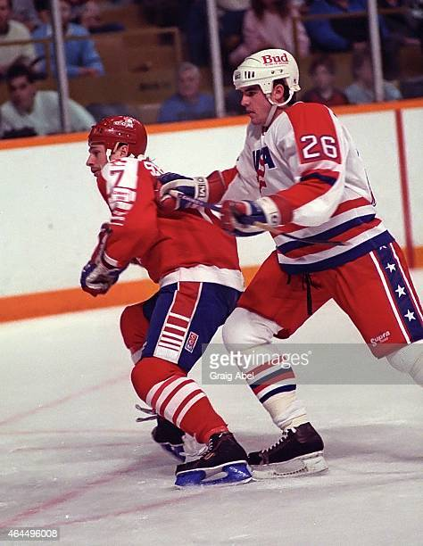 Wally Schreiber of Team Canada is checked by Peter Laviolette of Team USA during a warmup game for the 1988 Olympics on January 18 1988 at Maple Leaf...
