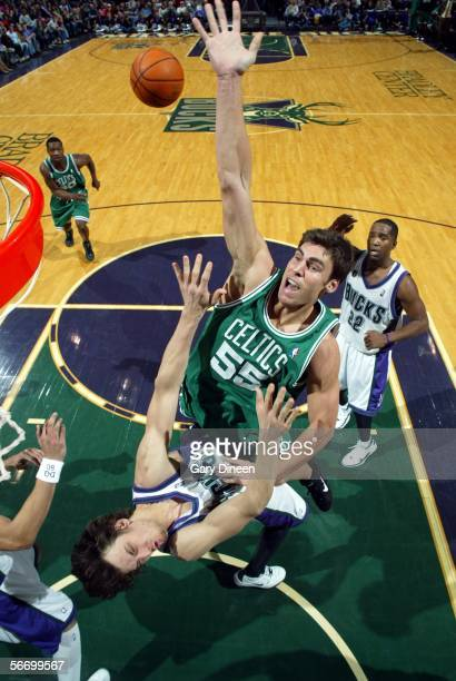 Wally Szczerbiak of the Boston Celtics is fouled after attempting a shot by Andrew Bogut of the Milwaukee Bucks on January 29 2006 at the Bradley...