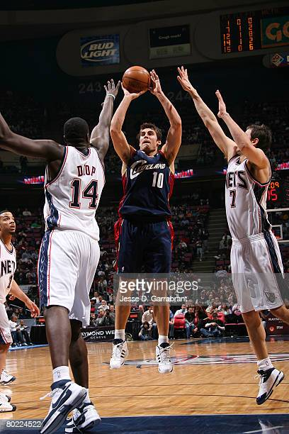 Wally Szczerbiak of the Cleveland Cavaliers shoots against DeSagana Diop and Bostjan Nachbar of the New Jersey Nets on March 12 2008 at the Izod...