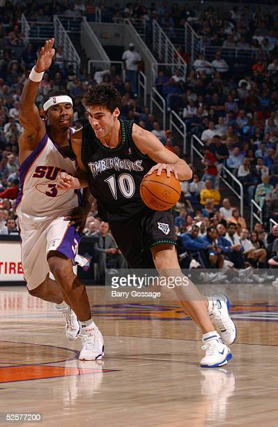 Wally Szczerbiak of the Minnesota Timberwolves drives against Quentin Richardson of the Phoenix Suns on April 1 2005 at America West Arena in Phoenix...