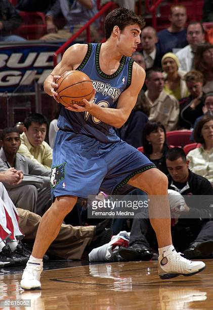 Wally Szczerbiak of the Minnesota Timberwolves drives to the basket against the Miami Heat during the game at American Airlines Arena on March 10...