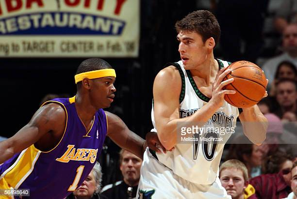 Wally Szczerbiak of the Minnesota Timberwolves is covered by Smush Parker of the Los Angeles Lakers on December 10 2005 at the Target Center in...