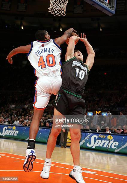 Wally Szczerbiak of the Minnesota Timberwolves is denied a basket by Kurt Thomas of the New York Knicks during their game on December 29 2004 at...