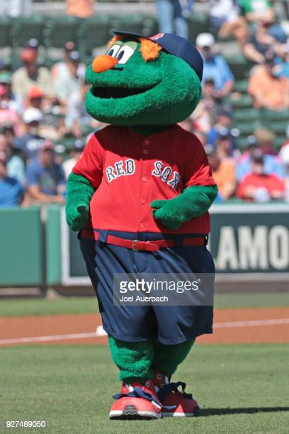 Wally the Boston Red Sox mascot entertains the fans prior to the start of the spring training game against the New York Yankees at JetBlue Park on...